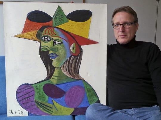 "Dutch art detective Arthur Brand with ""Buste de Femme,"" a recovered Picasso painting. The painting was stolen from a wealthy Saudi's yacht 20 years ago."