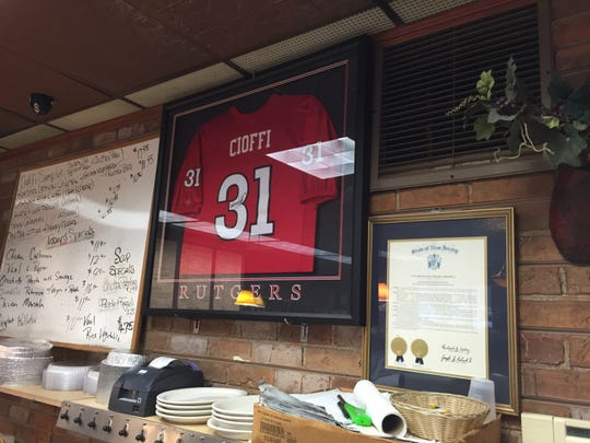Rutgers cornerback Anthony Cioffi's framed jersey hangs on the wall at his family's deli in Springfield.