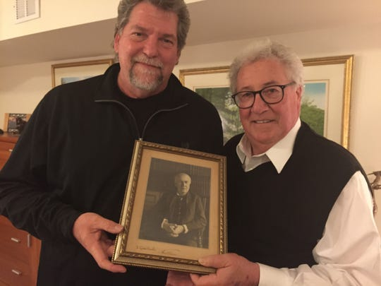 Guido Ciccolini's grandsons Joe Petillo (left) and Jim Petillo hold an autographed portrait of Thomas Edison that the inventor personalized to their opera tenor grandfather.