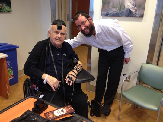 Wall, NJ The late Howard Feinstein (L) wearing the tefillin with Rabbi Zalman Notick of Chicago. The Congregation Sons of Israel in Manalapan will dedicate a special pair tefillin in honor of late congregant Howard Feinstein. photo by courtesy of Susan Feinstein