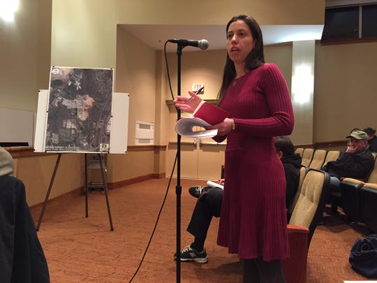 Stacy Jones, Tinton Falls, questions a traffic expert for Jersey Shore MotoCross at a Tinton Falls Zoning Board hearing Thursday.