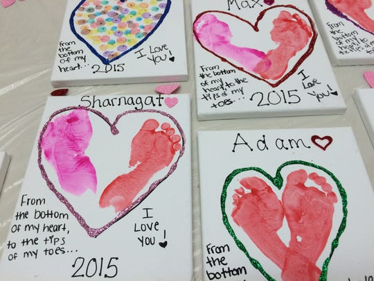 To get the footprints on paper, teachers and parents painted the feet of the toddlers and let them step on pieces of paper to create the hearts. The fundraiser was held in conjunction with Valentine's Day, but could be held at any time of the year.