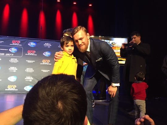 UFC star Conor McGregor meets a young fan after a UFC World Tour press event Thursday at the Beacon Theatre in New York.