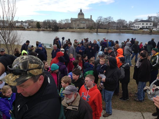 Kids and their families gather at Spring Lake to help with stocking ahead of the annual trout contest.