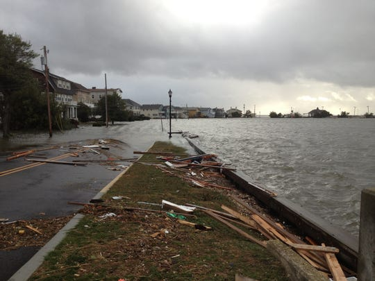 Flooding and damage along Edgemont Drive and Deal Lake in Loch Arbour after superstorm Sandy.