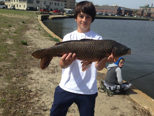 Zach Frankel, 14, of Wall, caught this 8.6-pound carp to take the junior division at the Deal Lake Carp Fishing Contest.