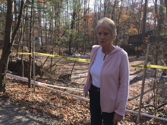 Dot Rice stands before a vapor collection system designed to capture toxic fumes from groundwater that had leached through the nearby CTS property in this 2014 photo. Rice first sounded the alarm about contamination at her home coming from the old CTS site in 1999.