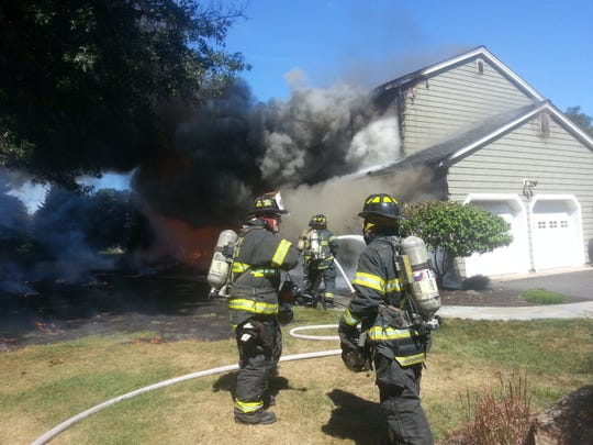 Firefighters put out a fire that broke out at 14 North Ryland Road in Whitehouse Friday.