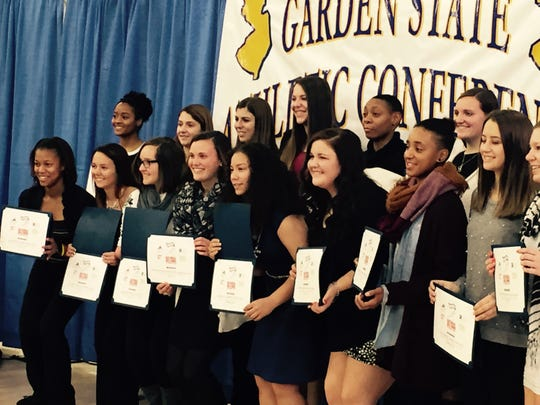 Raritan Valley Community College Basketball player Ashlyee Alston of Edison was recognized for her commitment and dedication to women's athletics during National Girls and Women in Sports Day, conducted on Feb. 1 at Seton Hall University in South Orange. The program was hosted by the New Jersey Association of Intercollegiate Athletics for Women (NJAIAW). Alston, third from the right in the front row with a scarf around her neck, is shown with the other recognized student-athletes who were honored at half-time of a women's basketball game featuring Seton Hall vs. St. John's University. Each year NJAIAW hosts the Woman of the Year Luncheon as part of National Girls and Women in Sports Day. The event recognizes the outstanding achievements of female collegiate athletes. For additional information, visit www.RVCCathletics.com.
