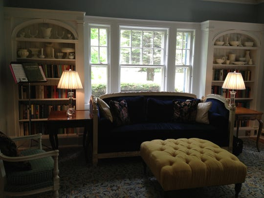 A tufted ottoman table sits at one of the end of the living room at 309 Willard Street.