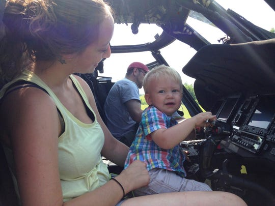Monique Hemme of Huntington and her son Ethan Hemme explore a Black Hawk helicopter on Saturday.
