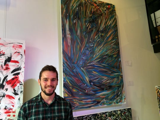 "Artist Michael ""Micko"" Gendron stands in front of his work at Art Focus in Sherbrooke."