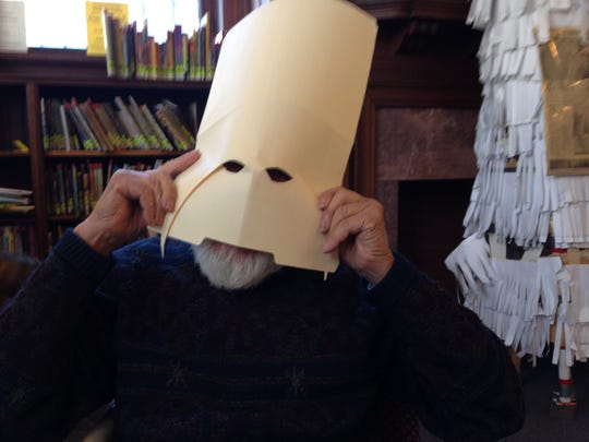 Frank Gonzalez wears a mask that's about as simple as they come, made from a file folder.