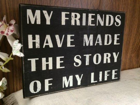 A sign sits on a shelf at the Book Worm's Exchange in South Burlington.