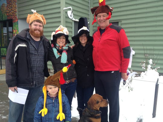 Jake Spillane, from left, Ryder Seavey, Courtney Seavey, Heidi Seavey and Chris Jacob, along with Bongo the dog, explored downtown Burlington on Thanksgiving in a competitive family-and-friends scavenger hunt.