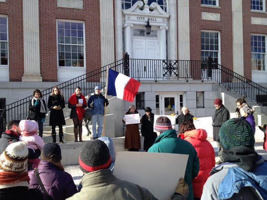 The Alliance Française of the Lake Champlain Region organized a moment of silence Saturday outside Burlington City Hall to remember the victims of the attack on the Charlie Hebdo magazine in Paris.