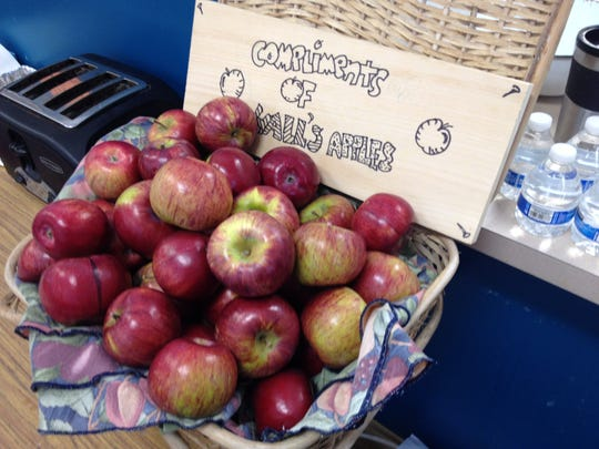 Complimentary local apples are among the refreshments at the Isle La Motte town meeting on Saturday.