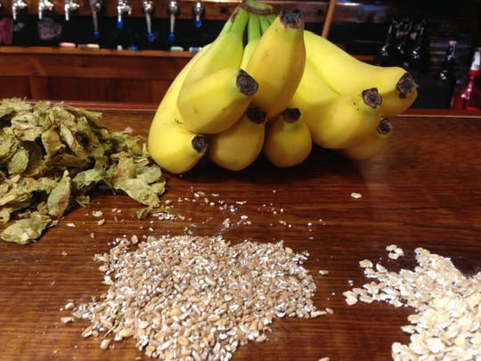 Grain, hops and bananas on the counter at Four Quarters Brewing in Winooski. The ingredients are for brewing a specialty beer, Funky Monkey, in collaboration with the Monkey House to celebrate the one year anniversary of Four Quarters.