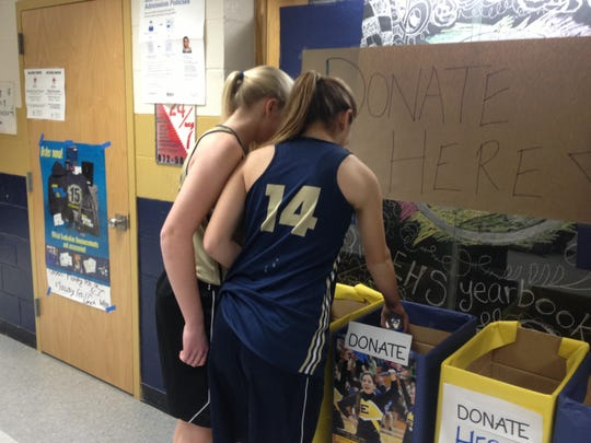 Students at Essex High School donate items during the recent community service contest.
