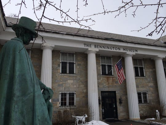 A statue of Abraham Lincoln stands outside the Bennington Museum.