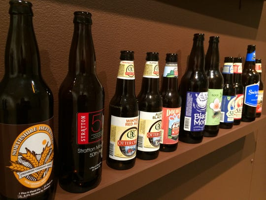 "Bottles representing Vermont's recent boom in craft beer line a shelf at the Bennington Museum exhibit ""Alcohol in Vermont: Creation to Consumption, Tolerance to Temperance."""