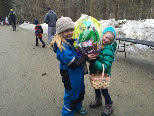 Hazel Czarnezki, 7, on left, and June Childs, 5, found a silver egg together. They decided to share the winning gift basket filled with spring time toys, including sidewalk chalk, markers and a bubble gun.