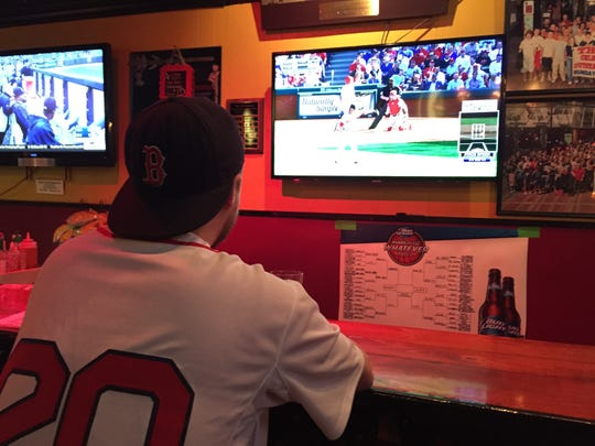 Chuck Whistler of Winooski Monday nurses a beer at Ken's Pizza & Pub on Church Street. Watching the season opener at Ken's has become a tradition for Whistler since 2013.