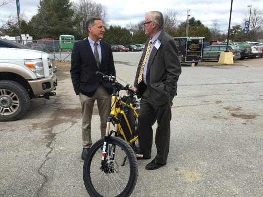 Jan van Eck, director of DJ Engineering, shows Gov. Peter Shumlin an electric bicycle at the Vermont Marketplace Saturday in Essex Junction. Van Eck said he and his son, Erik van Eck, of Burlington designed the bicycle and will soon begin taking orders to make more.