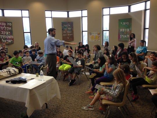 Rabbi Micah Peltz in front of his students