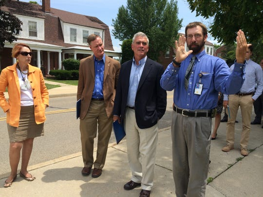 Ryan Jeter, of the Chillicothe Veterans Affairs Medical Center, leads U.S. Reps. Brad Wenstrup, middle, and Steve Stivers on a tour of the Chillicothe VA campus in 2014.