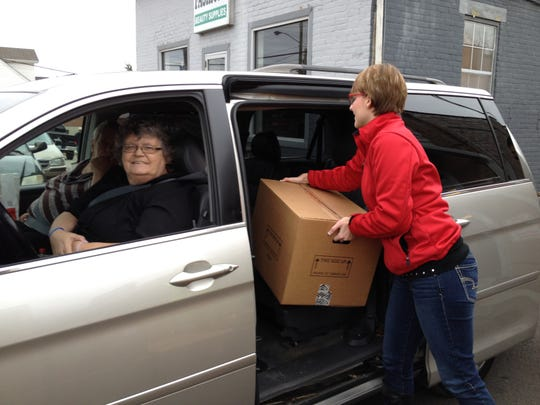 Brenda Henson, of Elsmere, drives up to receive her