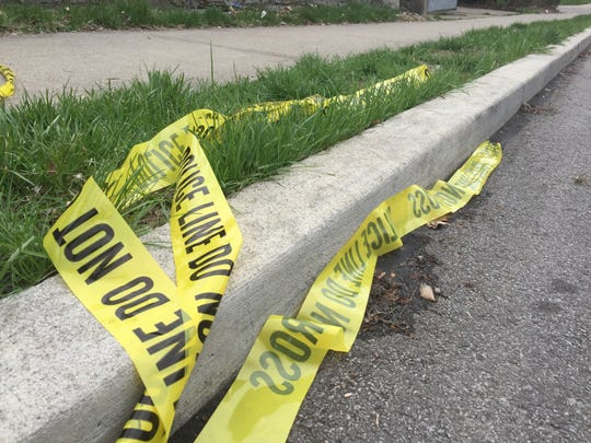 Broken police tape lays on the ground in Walnut Hills Monday afternoon, days after Kelsie Crow was shot and killed.