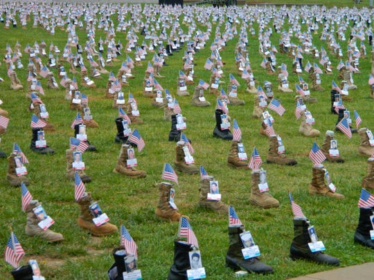 In late October, a last-minute push by Survivor Outreach Services volunteers led to the completion of a massive memorial display at Fort Campbell honoring nearly 7,000 service members fallen since 9/11.