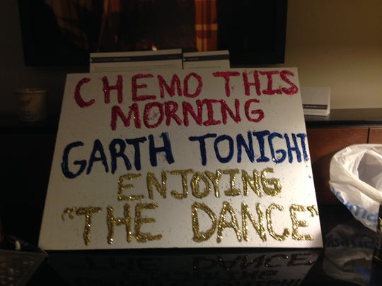 Teresa Shaw of Osage held this homemade glittery sign at a Garth Brooks concert on Nov. 7 in Minneapolis. The country singer stopped his show to address her cancer battle.