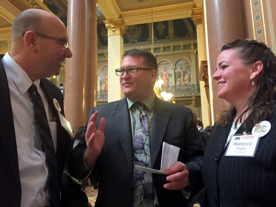 State Sen. Steve Sodders, center, talked Wednesday at the Iowa Capitol with Allen Burt of Marshalltown and Rebecca Dostal of Traer, who are both Iowa Farm Bureau members. They were among 200 Farm Bureau members who flooded the Iowa Capitol on Wednesday to urged suppport for a 10-cent per gallon increase in the state's gasoline and diesel fuel tax. The money would be used to pay for repairs to state, city and county roads. Sodders, a Democrat from State Center, said he was undecided whether he would vote for the gas tax bill.