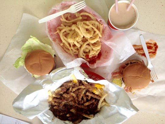 Chili King grub (from left): the Fatlady, onion rings, chili cheese fries, Twinburger and a chocolate shake.