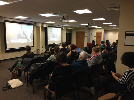 Students and faculty at the University of Michigan watch Missouri governor's press conference ahead of the Ferguson grand jury announcement on Monday.