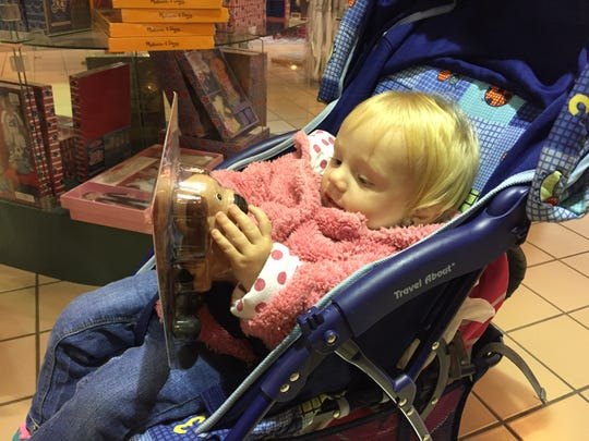 Annabell Rounds, 1, of Horseheads looks over a toy
