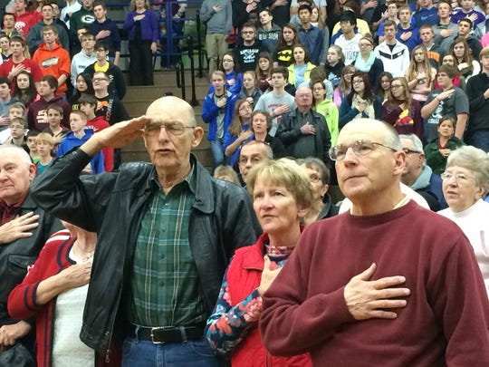 Area veterans and students join in the Pledge of Allegiance during a Veterans Day program at Winnebago Lutheran Academy on Monday, Nov. 10.