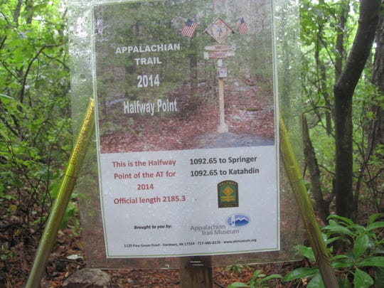 A sign marks the halfway point on the Appalachian Trail.