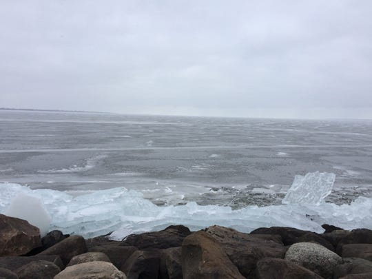 Ice shoves rest along the shoreline next to the lighthouse in Lakeside Park. Fond du Lac recently had warm, thawing temperatures, but colder weather has returned to the area.