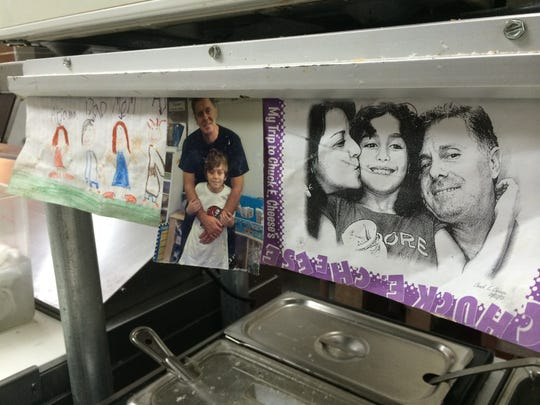 Pictures of owner Rex Rexhepi's wife and their two children hang above a prep table in the Bayshore Cafe kitchen. Family is one of the driving motivators behind this little North Fort Myers diner.