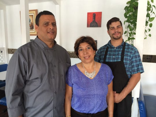 Juan Acosta, left, opened El Clandestino Restaurant in Cape Coral in August with his wife, Tatiana Fraga. Their son-in-law Bryan Formica is a server and deliveryman.