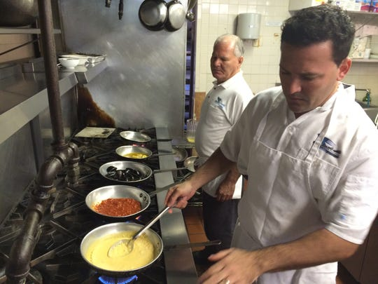 Vincenzo Puleio and his father, Angelo, prepare for dinner service at Enzo's in Bonita Springs.
