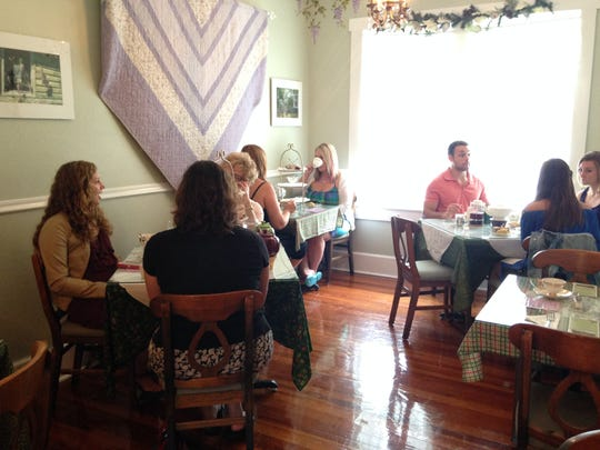 Patrons dine in at Wisteria Tea Room & Cafe during Art Walk.