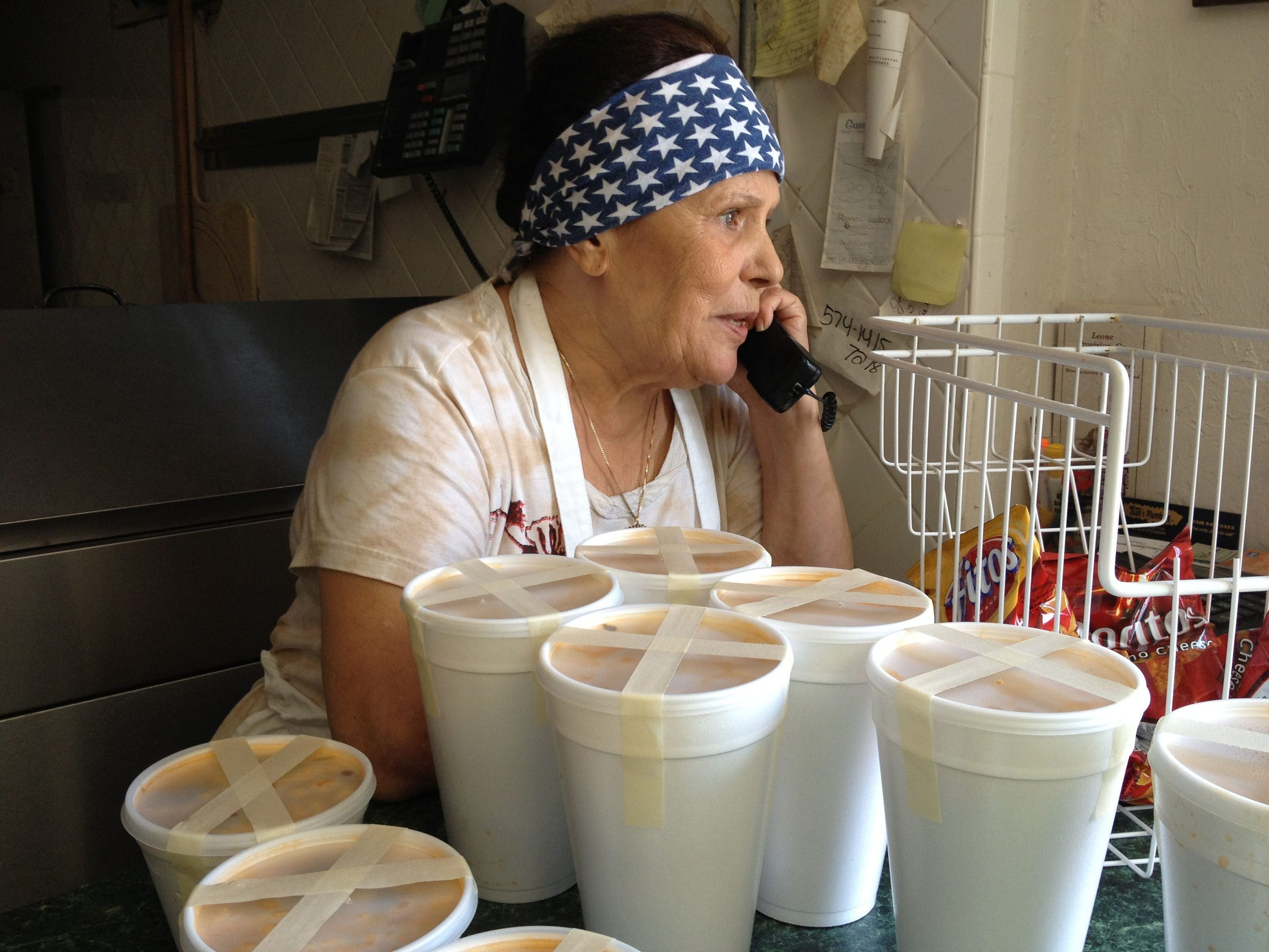 """In this 2013 photo, Rosaria """"Mama"""" Leone takes an order"""
