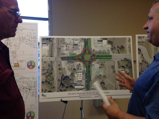 Bonita Springs resident John Conard and Councilman Mike Gibson look at design plans for a roundabout at Old 41 Road and Terry Street in downtown.