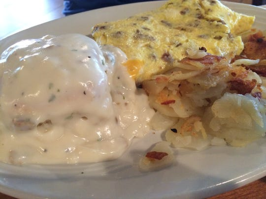 The Country Omelet from The Golden Fork Cafe is filled with sausage and cheese, and served with a biscuit and gravy.