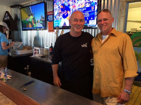 Lifelong friends John Lynch, left, and Jesse Tincher opened Blue Dog Bar & Grill on Matlacha in October.