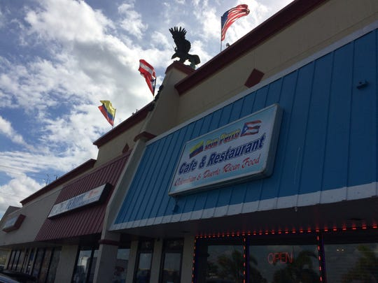 Flags from Colombia, Puerto Rico and the U.S. fly over Don Perro in Cape Coral.